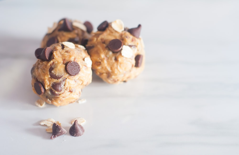 three round cookies with chocolate