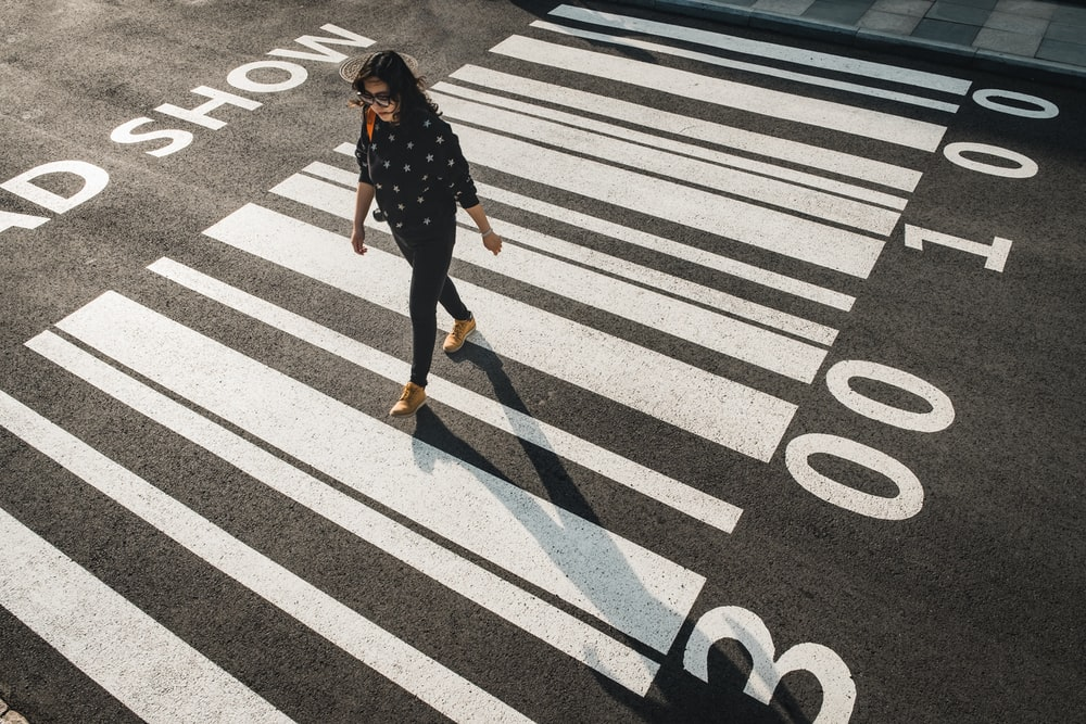 woman walking on pedestrian lane