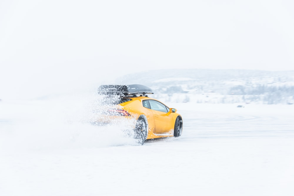 yellow coupe on snow field
