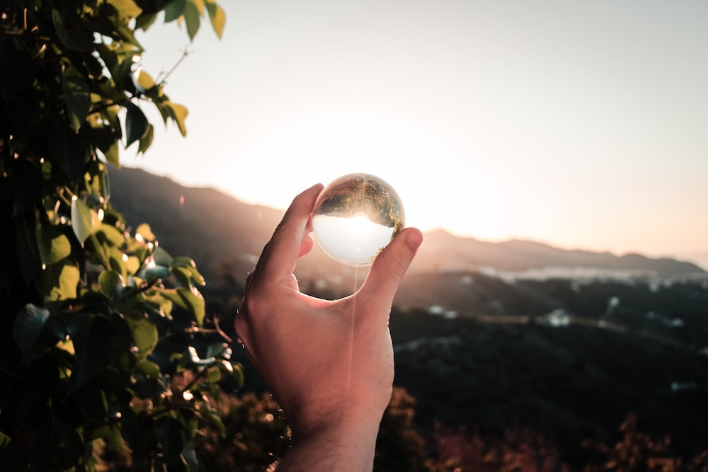 view of sun through clear glass sphere
