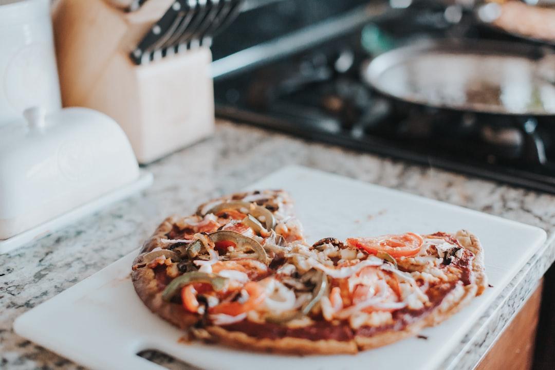 Pizza On White Chopping Board - unsplash
