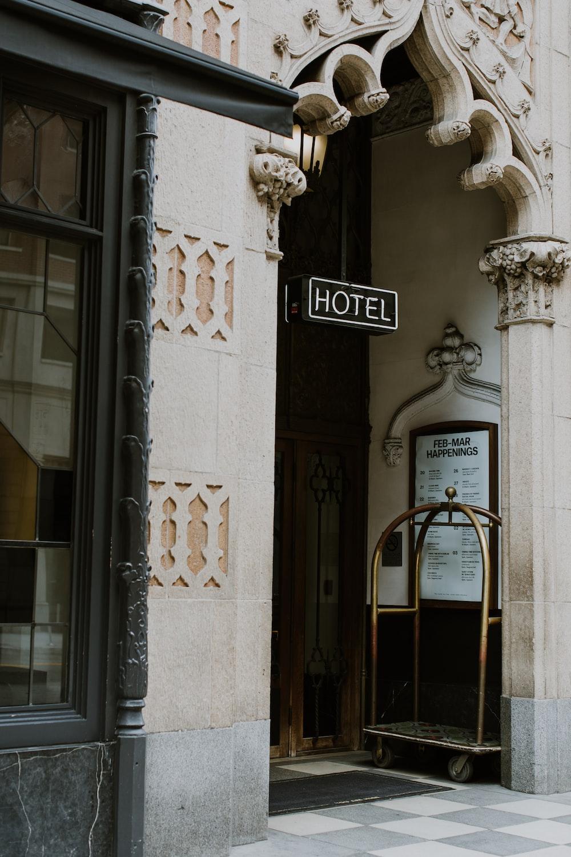 brown trolley under Hotel sign