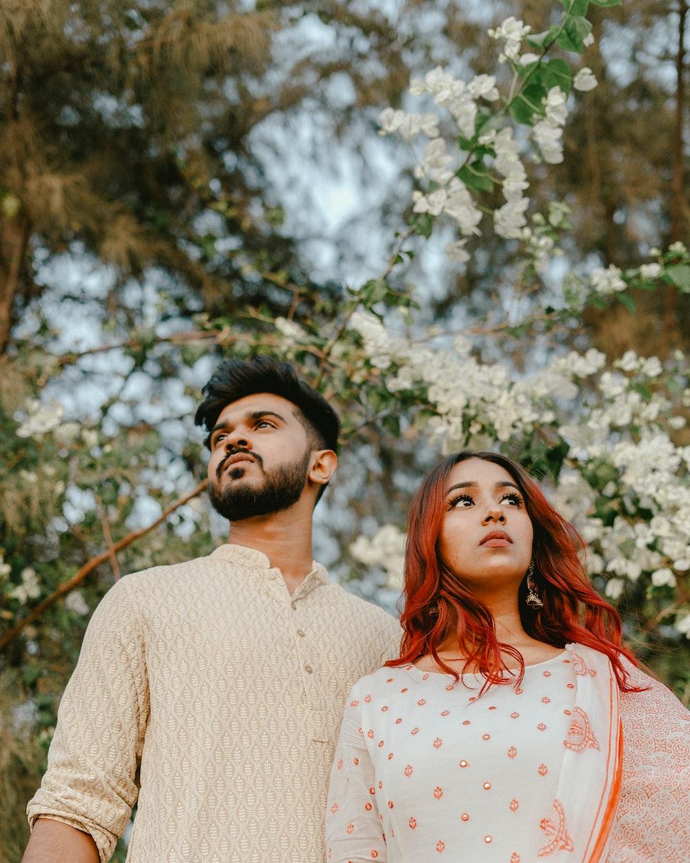 couple standing near tree