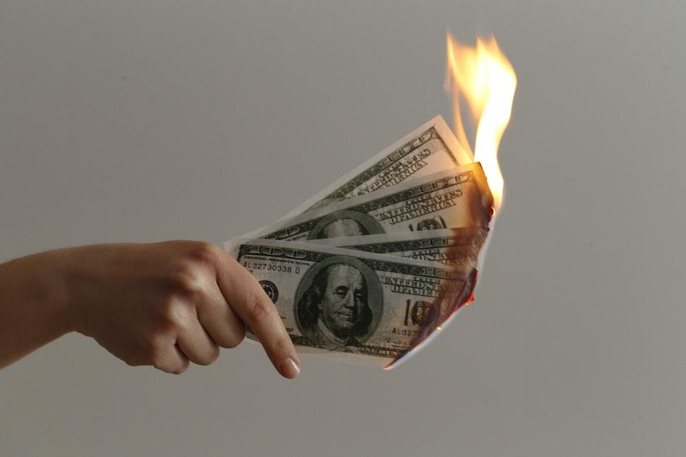 burned 100 US dollar banknotes