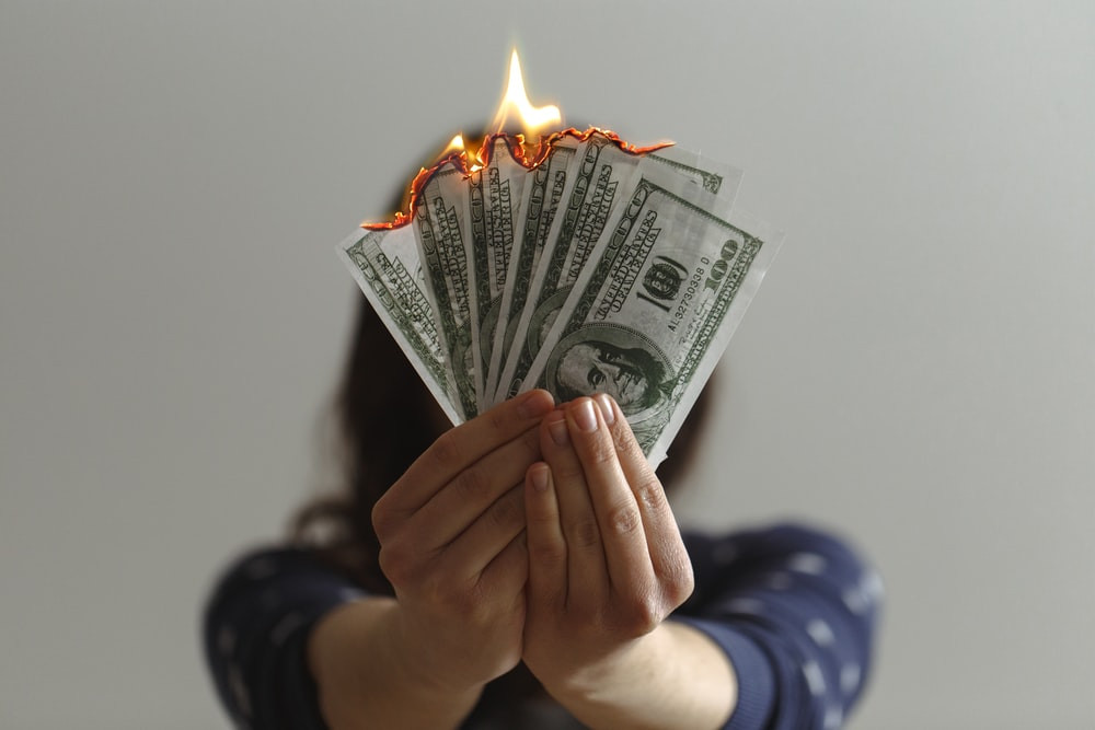 a fan of fake American dollars on fire