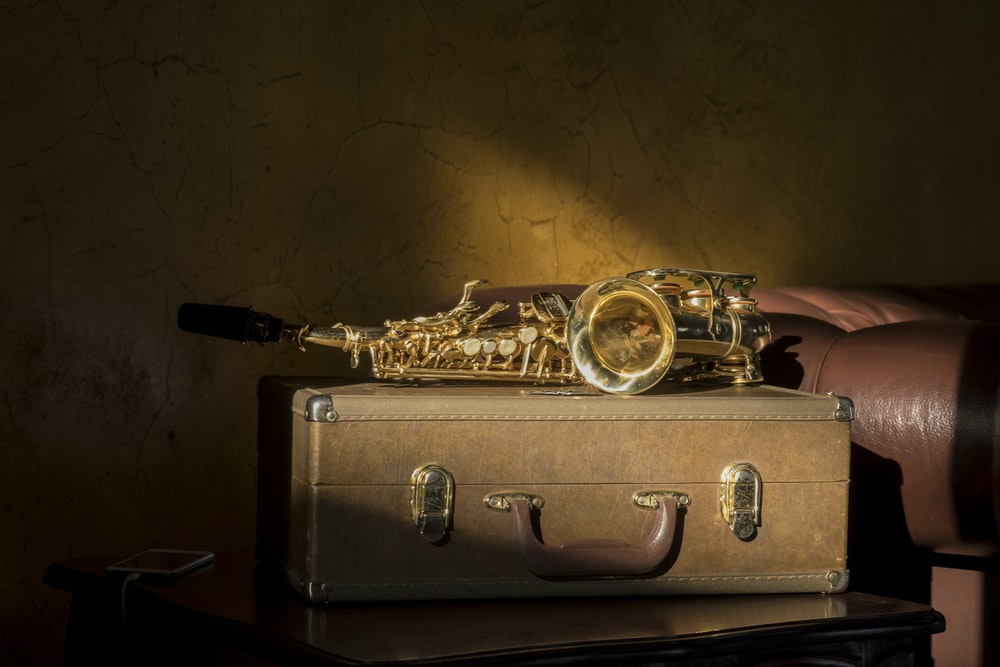 gold and black trumpet with box