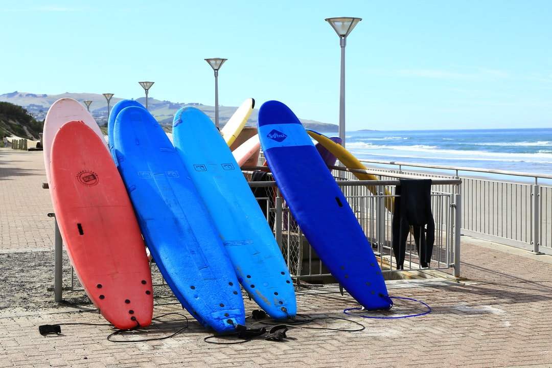Surf boards drying in the sun at ST Clair Beach, Dunedin, a popular spot for surfers.