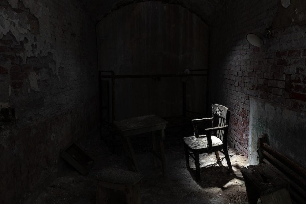 grayscale armchair near wall