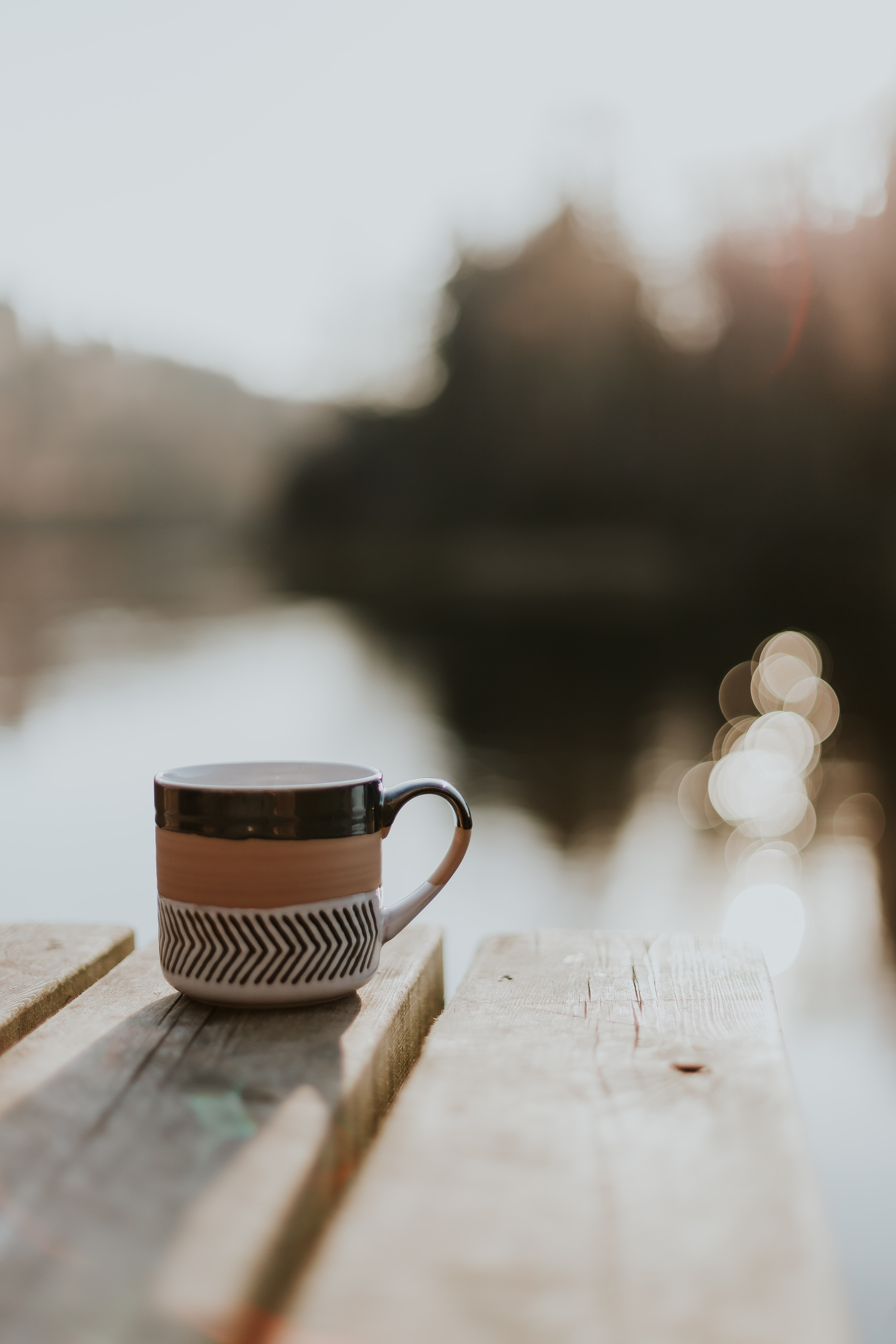 selective focus photography of cup