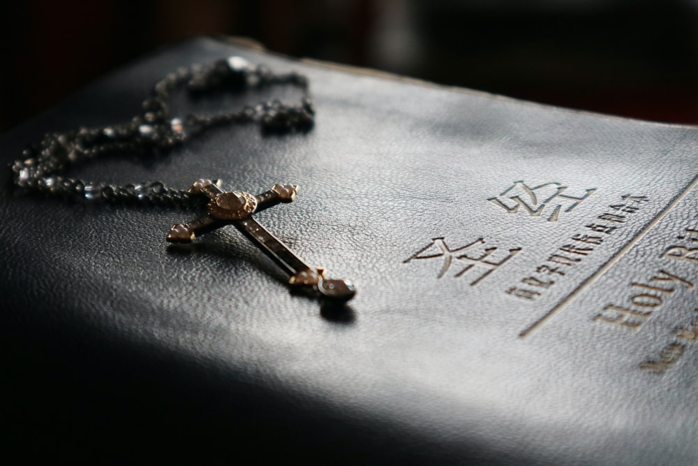 selective focus photography of rosary