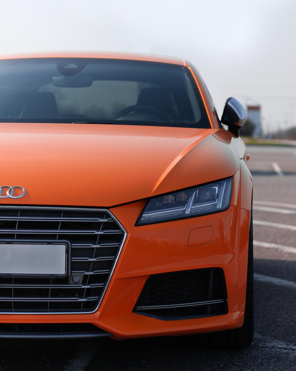 orange Audi vehicle
