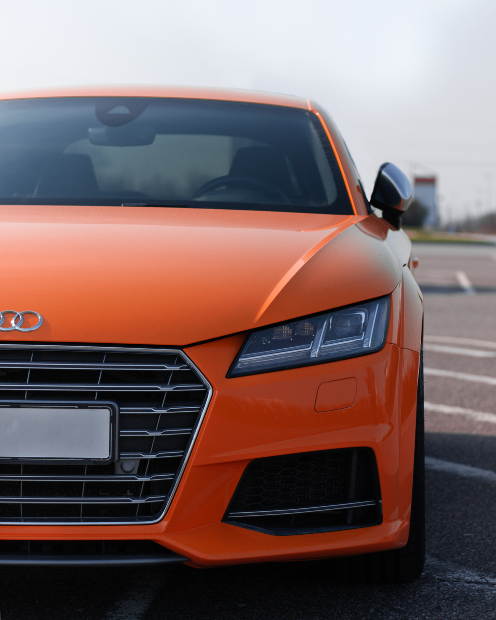 orange Audi vehicle