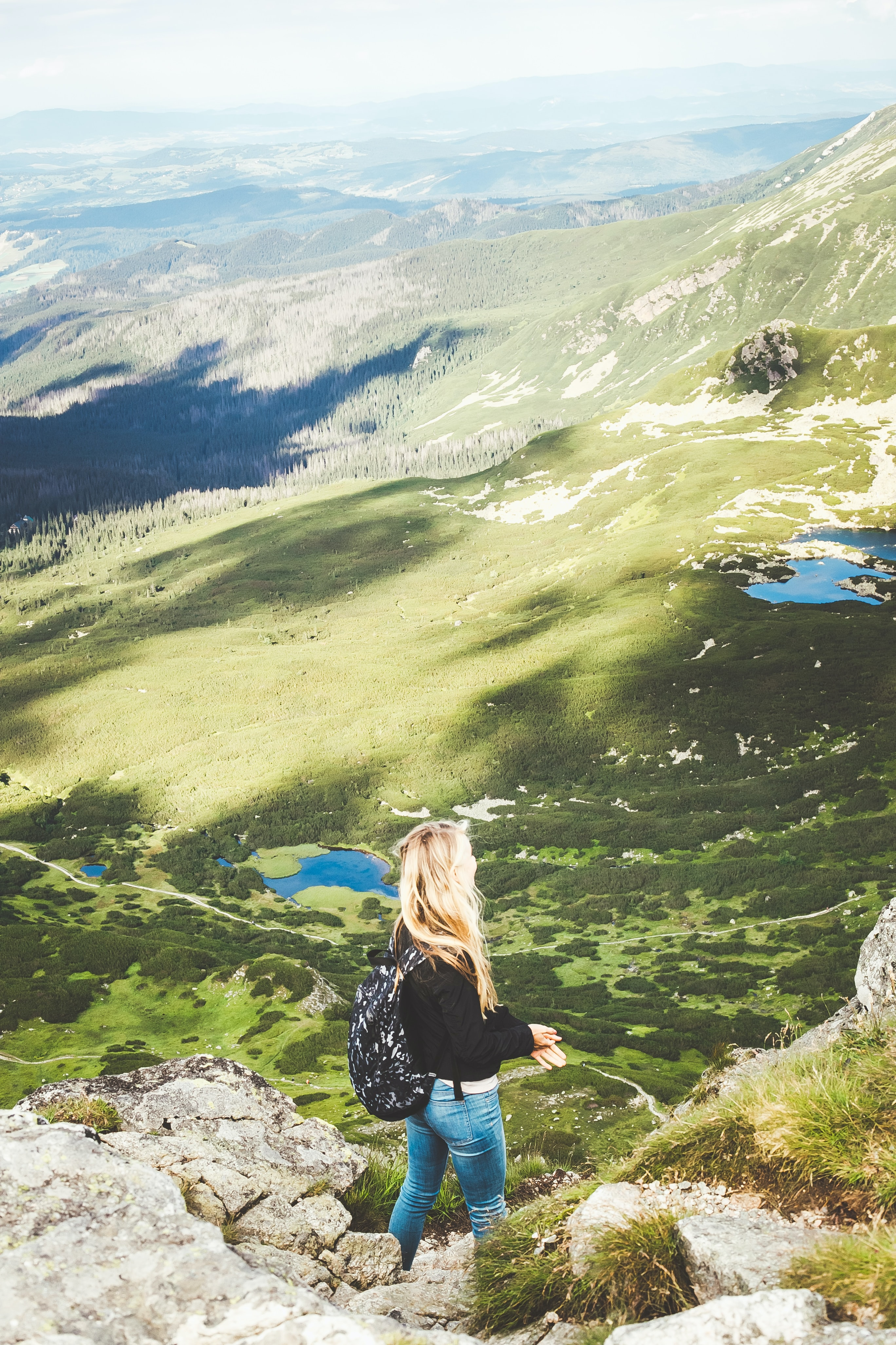 woman standing on mountain during daytime