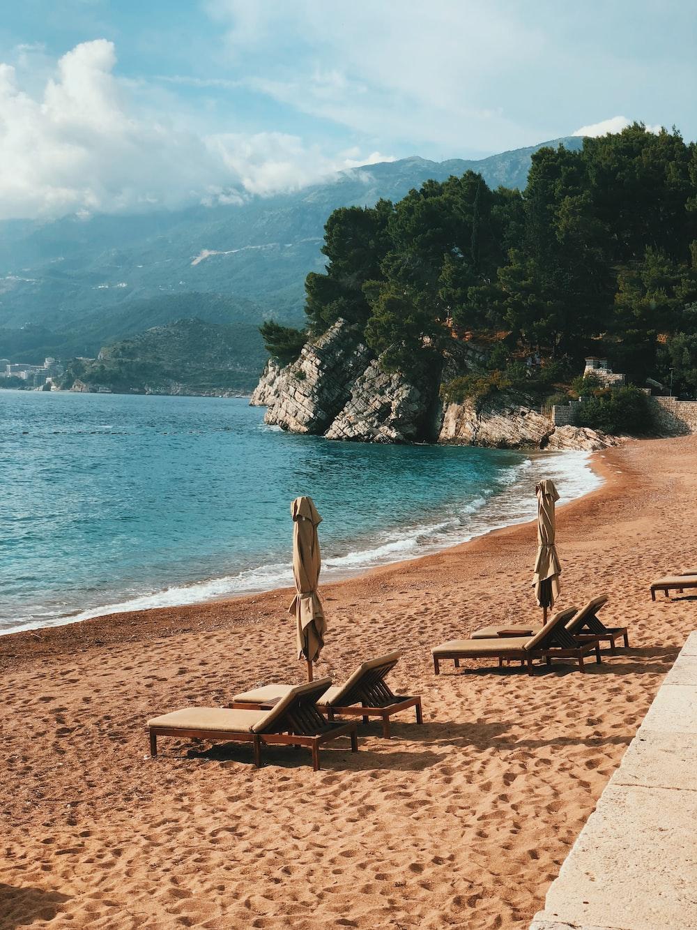 Empty Outdoor Loungers Near Shore