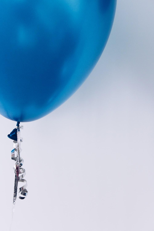blue flying balloon