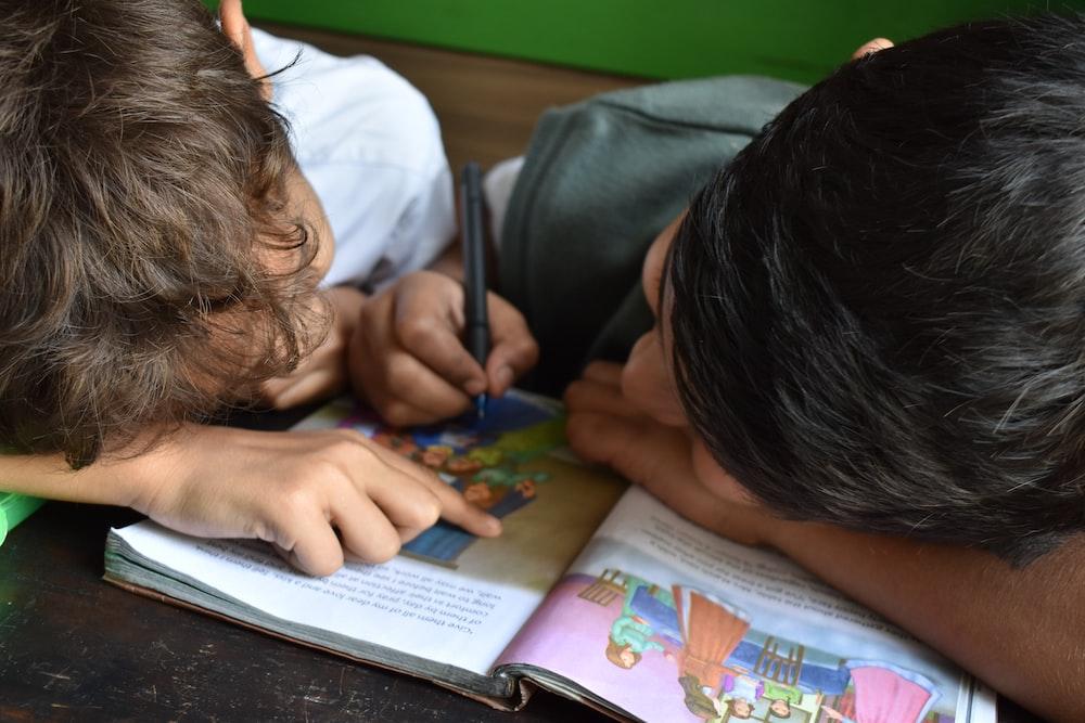boy's writing on book