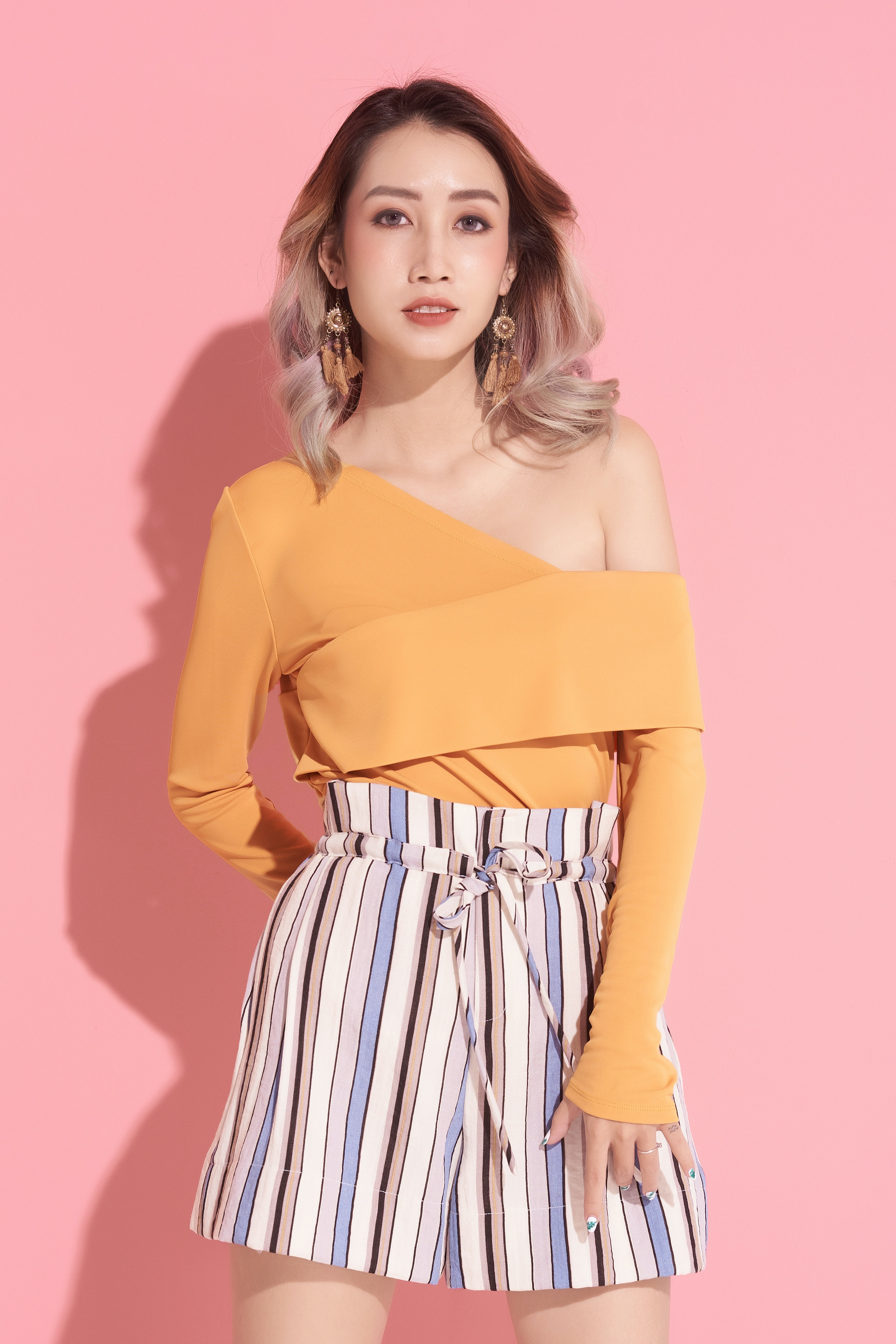 woman in orange one-shoulder top