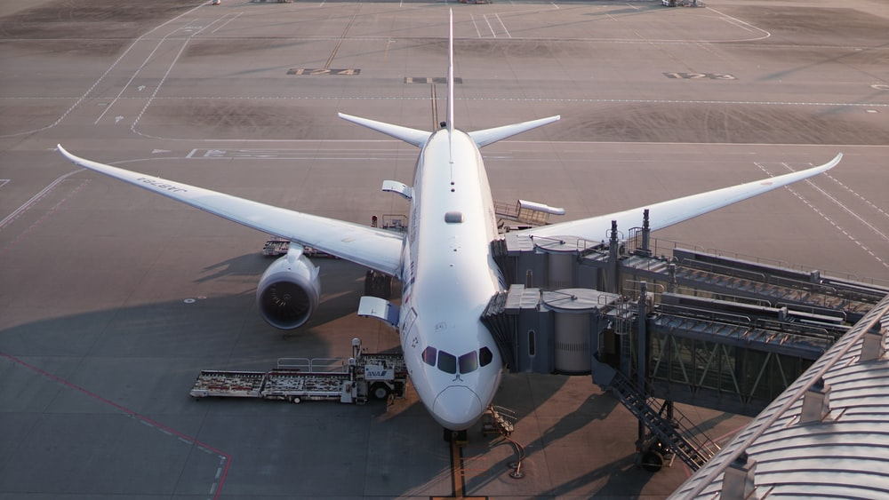 white airliner in airport