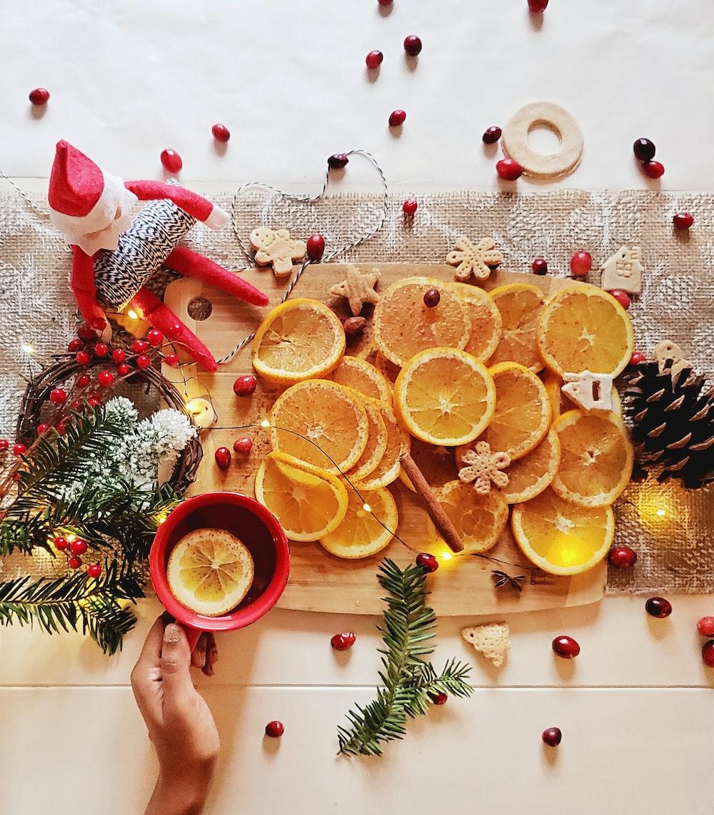 slice orange fruit on brown wooden chopping board
