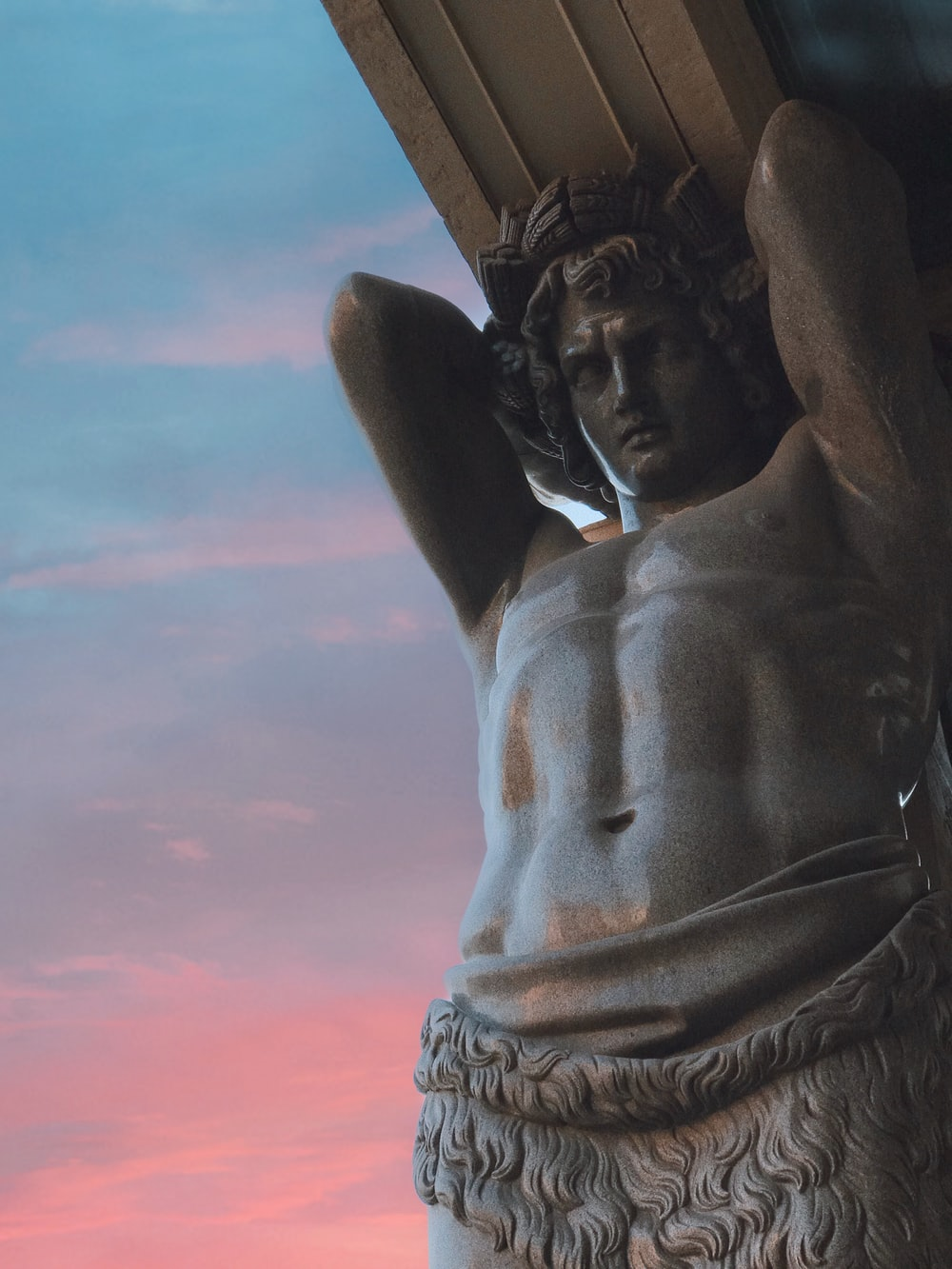standing person statue during golden hour