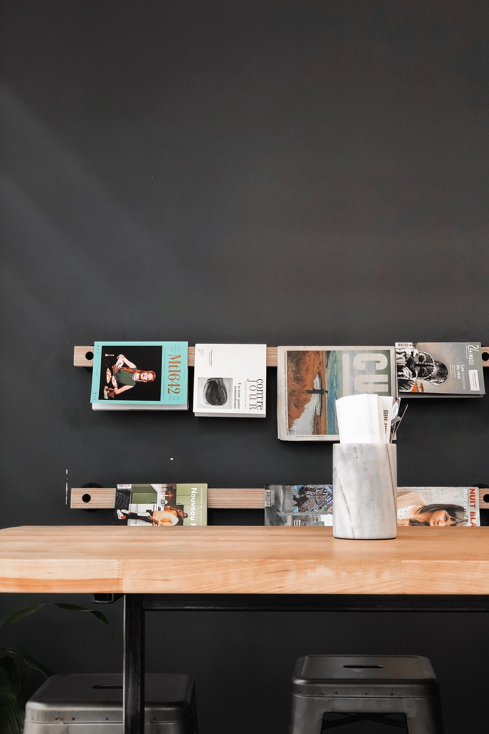 books and magazines hanged over wooden table