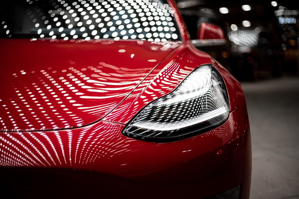 close-up photography of red car