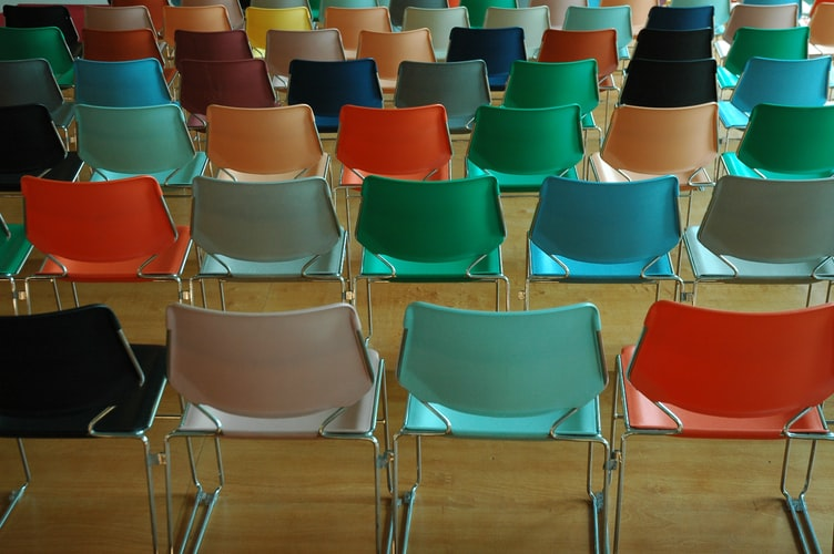 rows of colorful stacking chairs for fall of senior year class