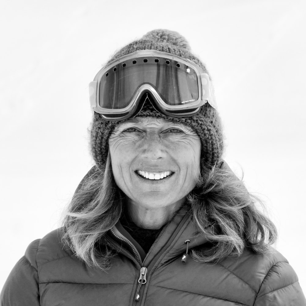 smiling woman wearing bubble jacket