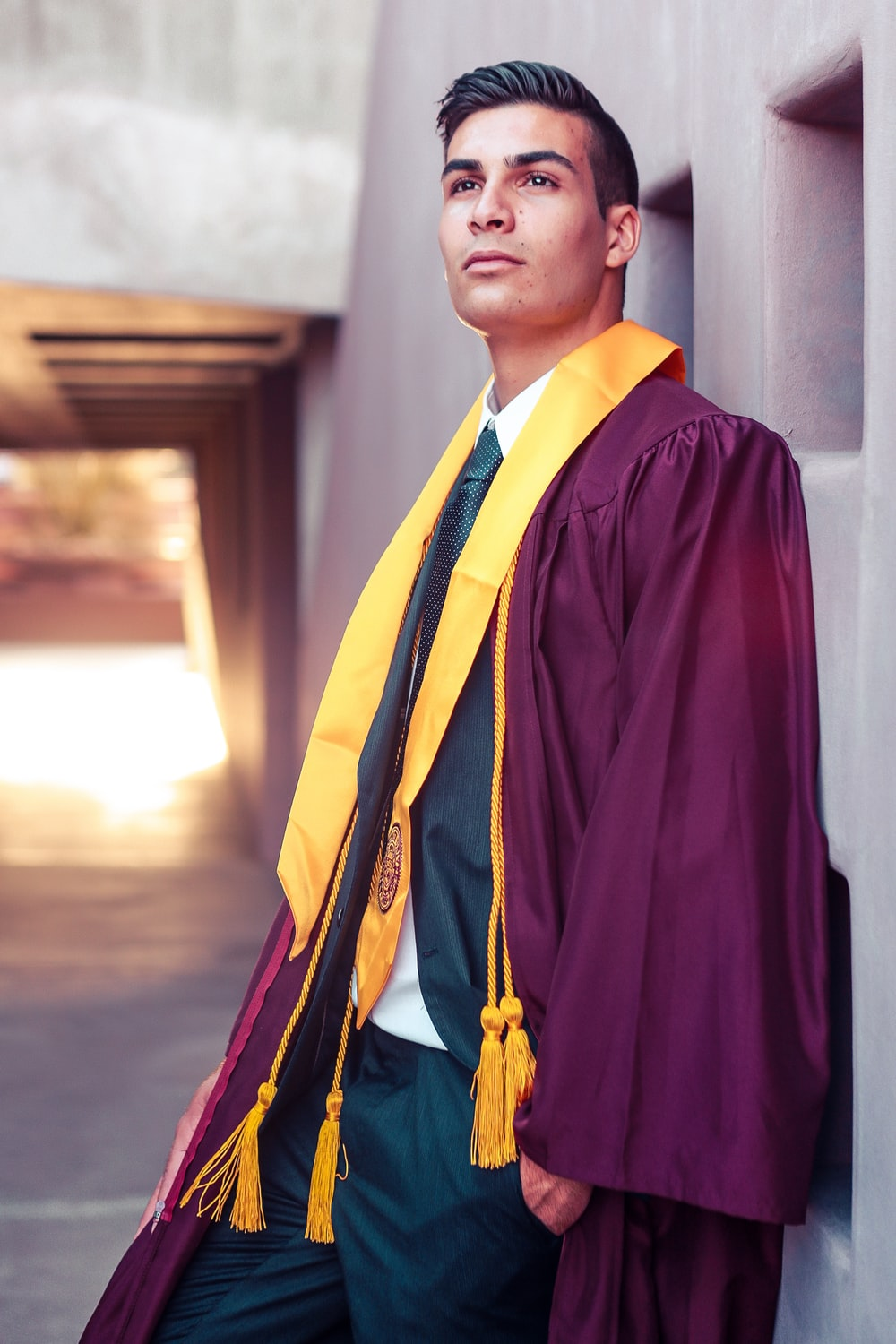 man standing while wearing purple academic gown