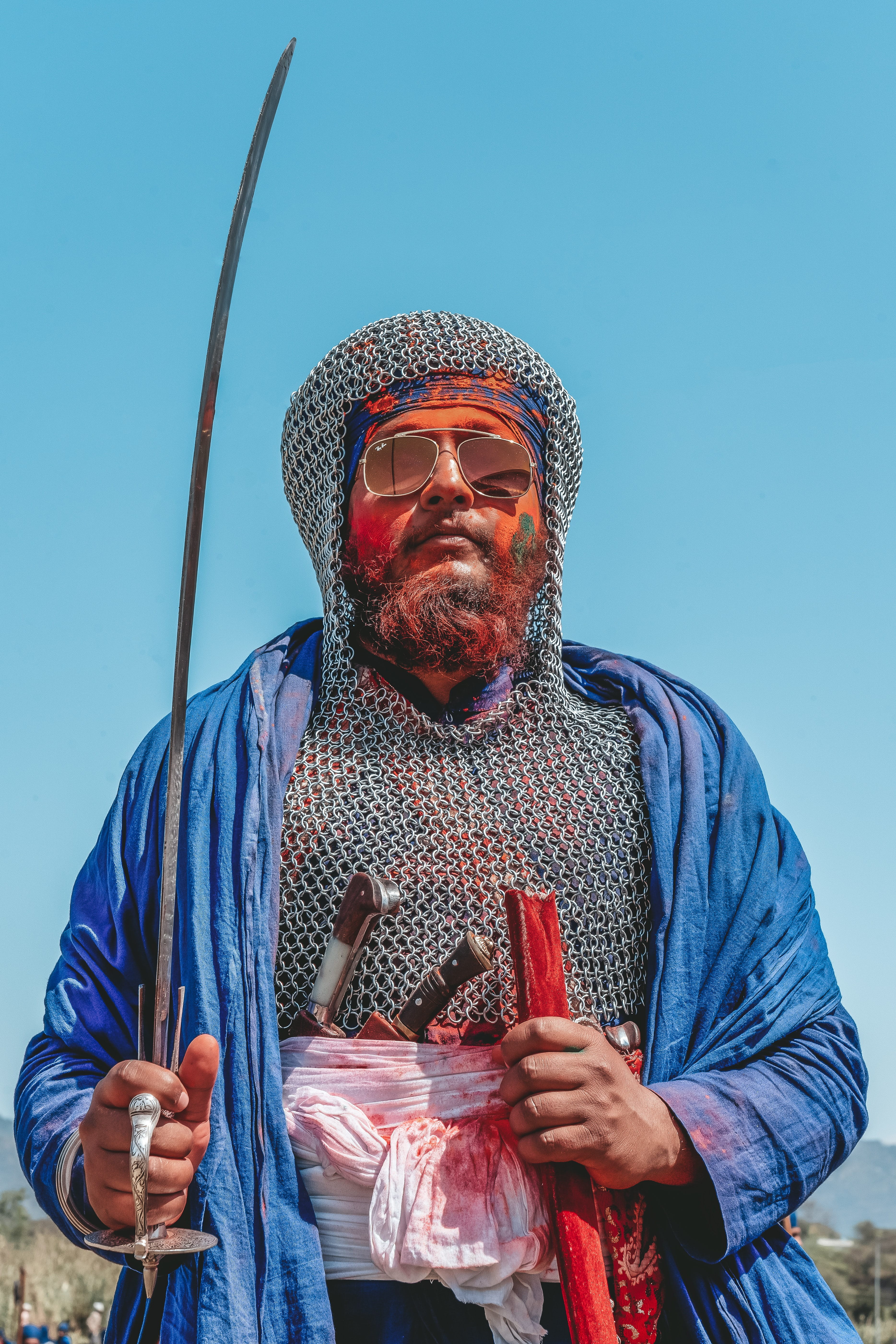 man holding sword with sunglasses