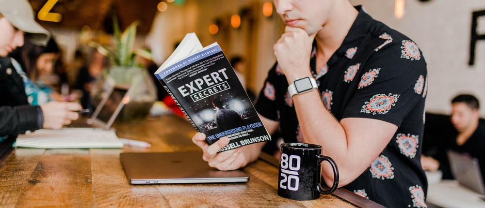 man reading affiliate marketing book