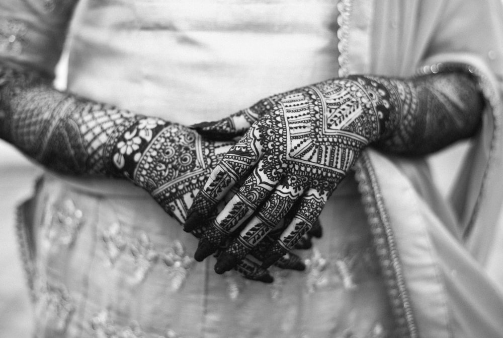 person with mendhi tattoo