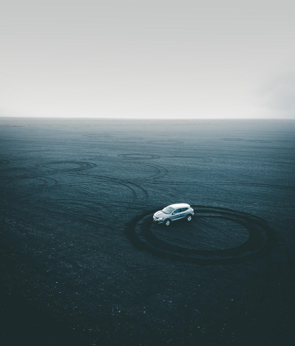 gray vehicle on gray sand