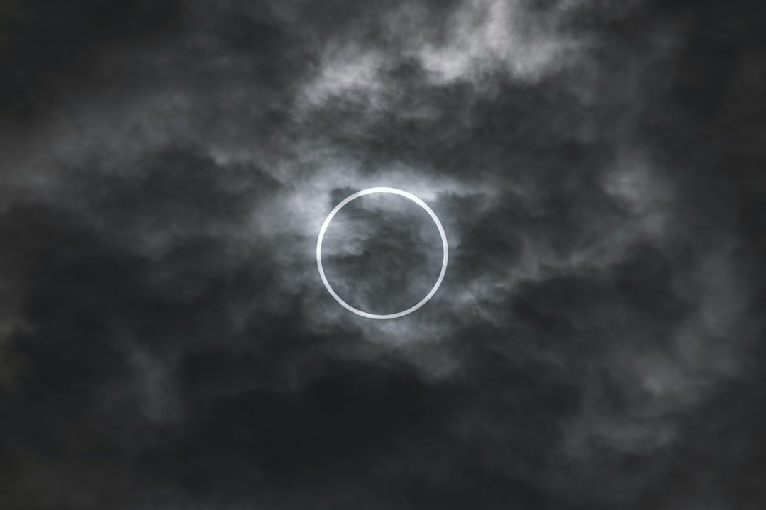 This is our star being eclipsed by our moon during an annular eclipse. I viewed this in Tokyo during the early hours of May 20th, 2012. I still remember the anticipation in everyone's faces due to the fact that the clouds would not open the sky to us but also because the light around us began to dim and we knew our window of opportunity to see the eclipse was fading. It was only in the last 10 or so minutes did the clouds thin out and leave a very translucent layer for the sun to be able to shine its light through for us to see a massive ring appear above us.