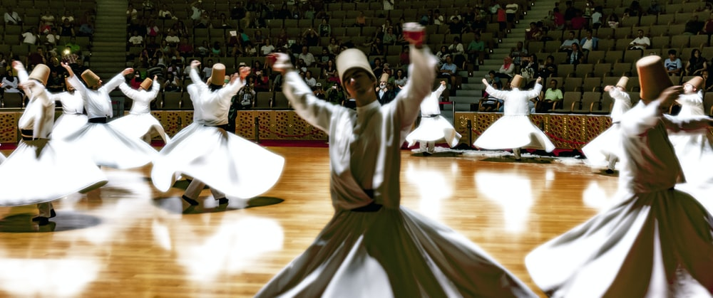 group of people dancing inside gymnasium