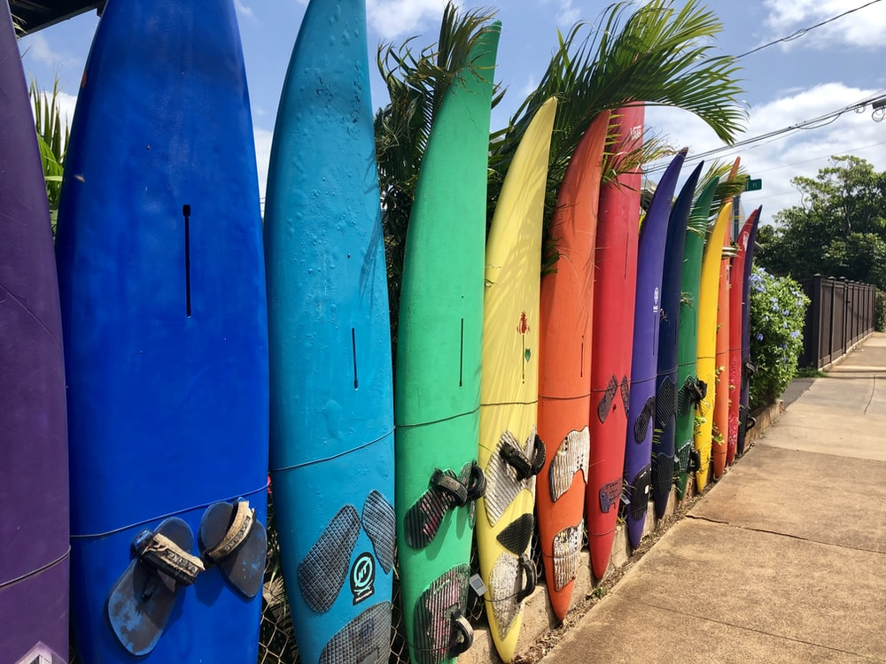 Add fun colourful elements to your bar with a few old surfboards.