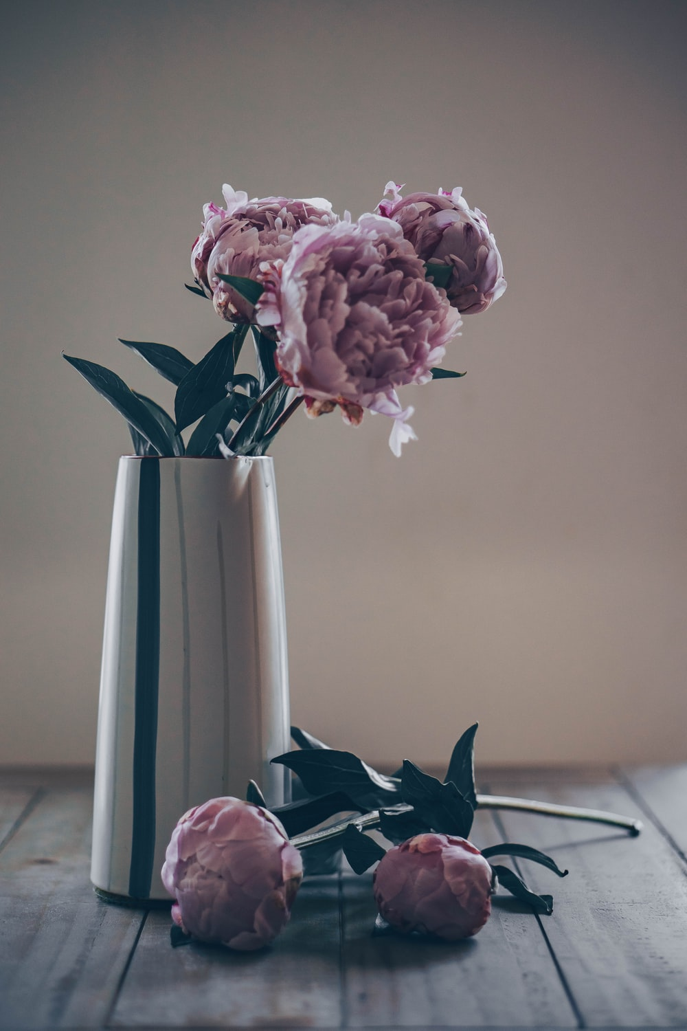 pink peonies in vase and table
