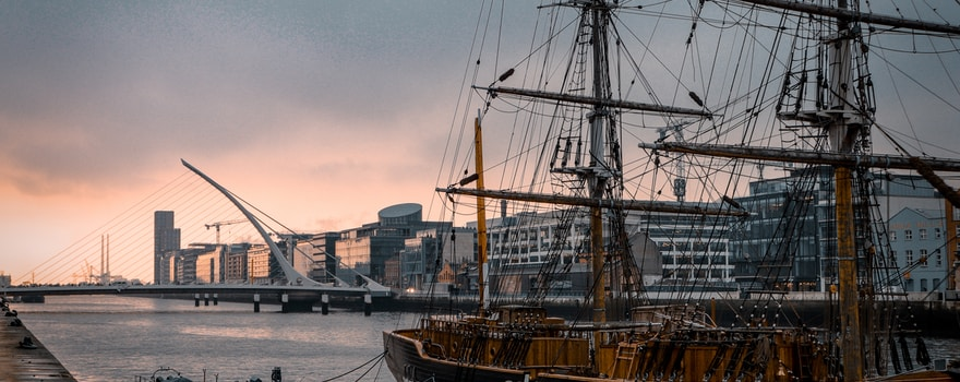 black and brown ship on body of water during daytime
