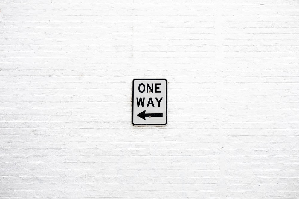 One Way arrow left signage