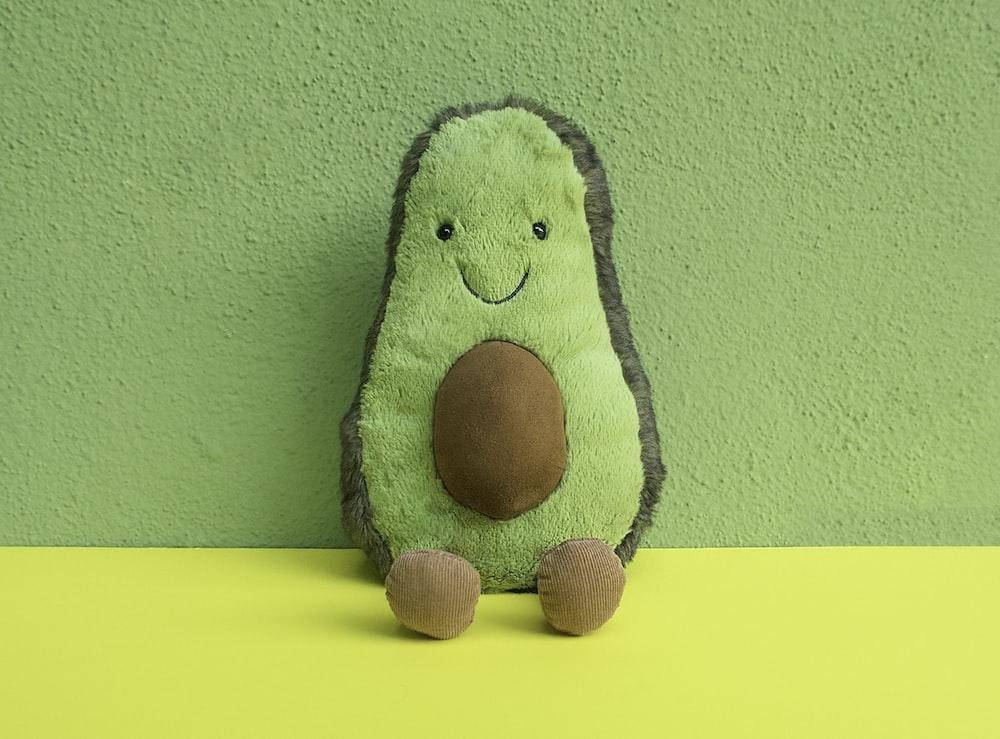 green and black animal plush toy