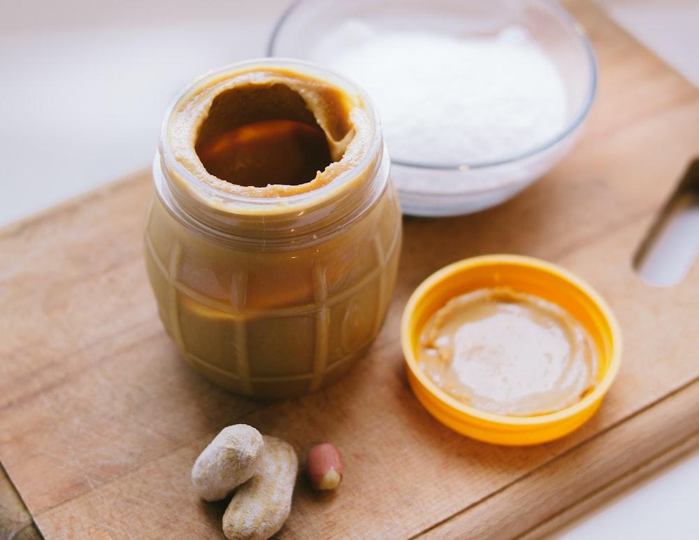 peanut butter jar on cutting board