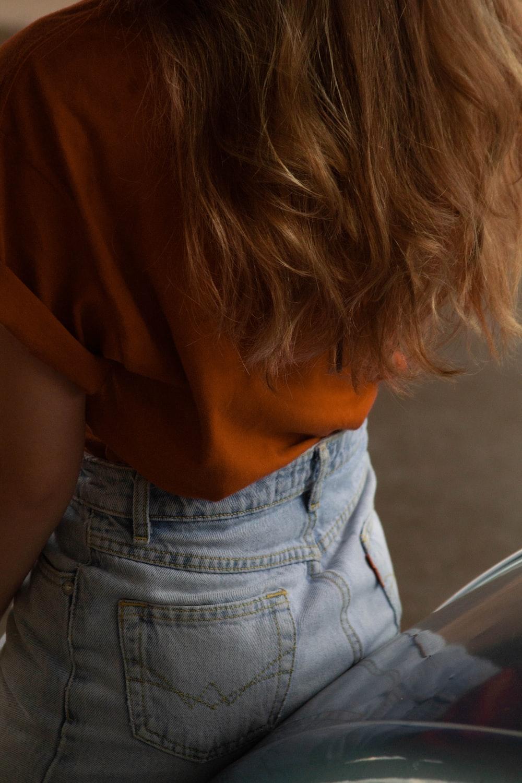 woman wearing blue denim jeans