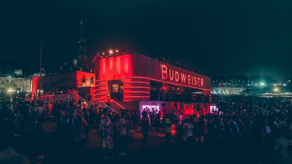 people gathered outside Budweiser stage at night