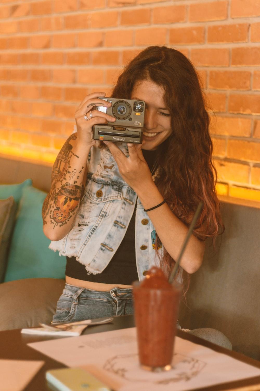 woman holding land camera