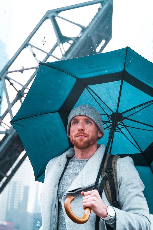 ma using umbrella under concrete bridger