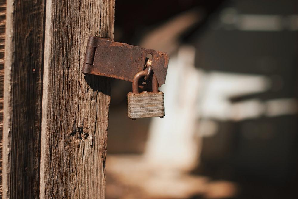 padlock on grey metal hinge