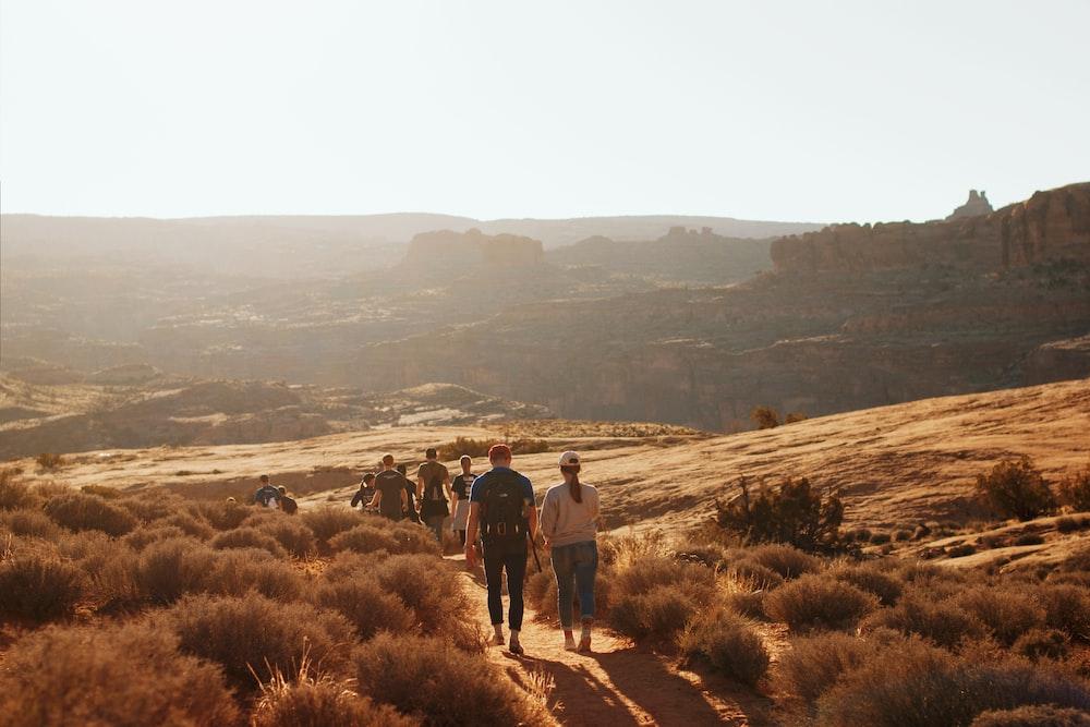 people walking desert