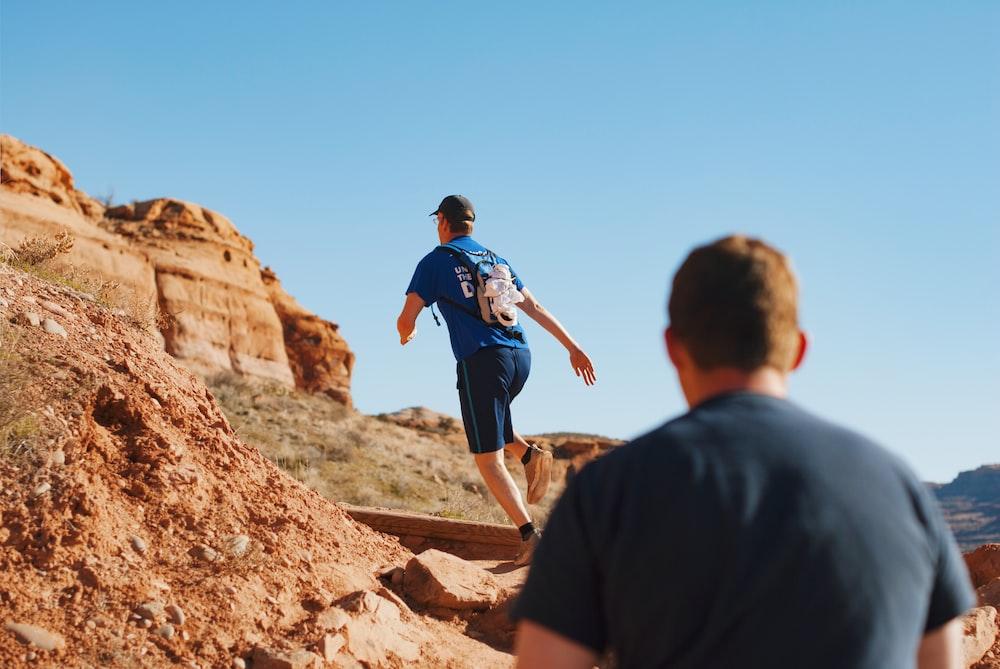 man running on boulder