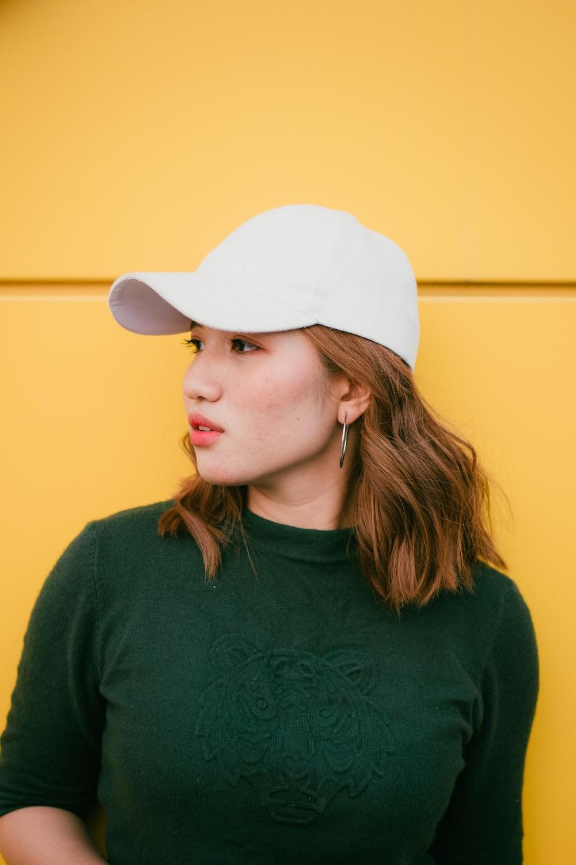 woman standing near yellow wall