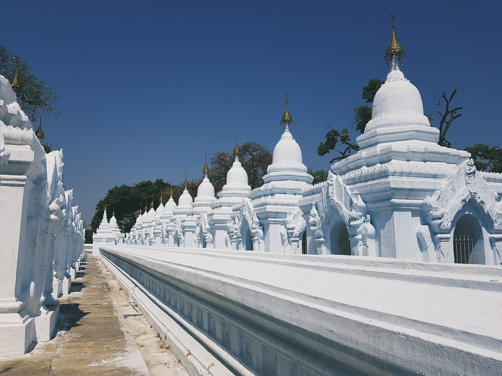 white concrete statue lot under clear blue sky during daytime
